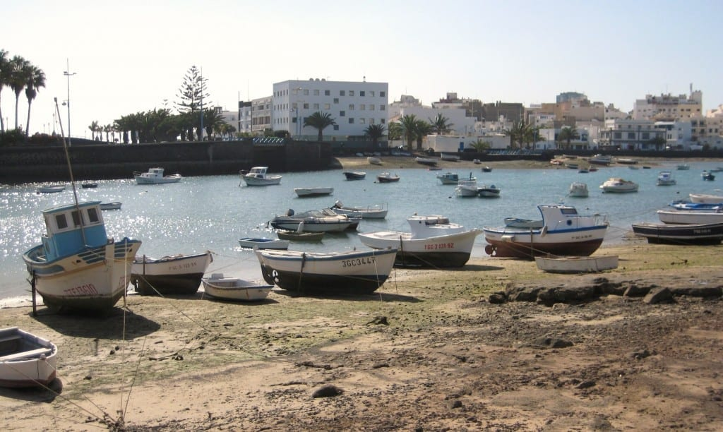 Boats high and dry in Lazarote during high tide