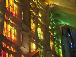 Morning sun paints Sagrada Familia interior.