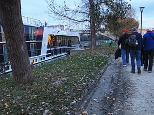 Passengers boarding AmaDagio walk past mud recently deposited when the Rhone rose above its banks.