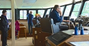 Passengers can come and go on the bridge, where Capt. Mike Bennett is at the wheel