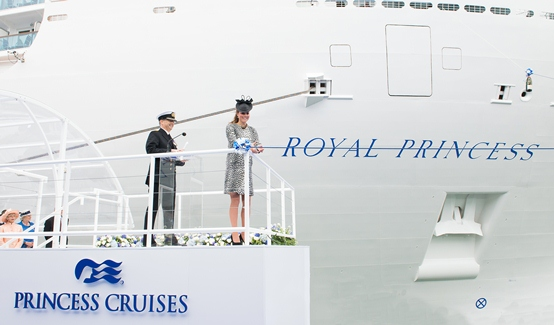 Her Royal Highness The Duchess of Cambridge cuts the ribbon to release the bottle of champagne to officially name Royal Princess.