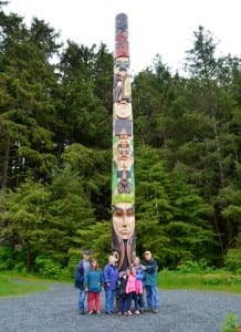 Gathered around a totem pole