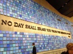 This remembrance wall is a piece of art...each paper square is a watercolor in a distinct shade of blue, honoring each person lost the day