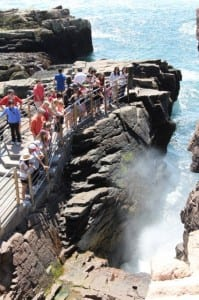 Thunder Hole is one of the landmarks-- that define Acadia National Park's rugged coastline