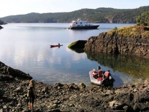 Safari Quest anchors off Jedediah Island Marine Provincial Park, British Columbia, for Un-Cruise passengers to kayak and ride a skiff to shore