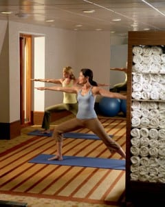Guests practice yoga in Crystal's Feng Shui fitness center.(photo courtesy of Crystal Cruises)
