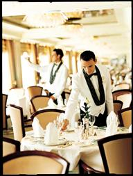 Waiters prepare the Crystal Dining Room for guests.