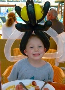 Creedon Boerner sports a balloon hat during lunch aboard the Carnival Magic.