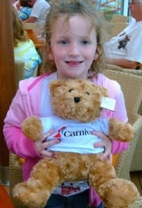 Payton Stinnett hugs her new Carnival Beary Buddy bear, part of the Carnival fundraiser for St. Jude's.