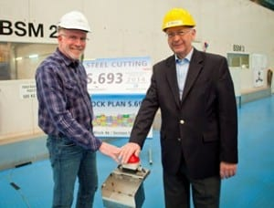 Kevin Sheehan, chief executive officer of Norwegian Cruise Line, and Bernard Meyer, managing director of MEYER WERFT, press the button to start the first steel cutting for Norwegian Escape. Photo courtesy of Norwegian Cruise Line