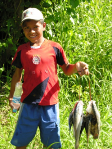 A boy in Urarina, Peru, said he speared these fish in the waters of the Upper Amazon