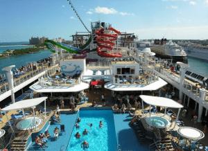 Busy pool deck, as Norwegian Getaway pulls into Nassau
