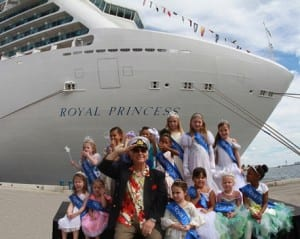 """Love Boat"" Captain Gavin MacLeod is joined by a court of young ""princesses"" who welcomed Royal Princess to Ft. Lauderdale for the first time. (Photo courtesy of Princess Cruises)"