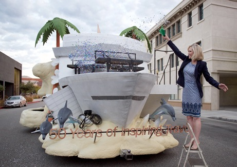 Julie Benson christens the Princess Cruises' float for the Rose Parade